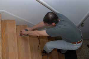 Sanding wooden stairs