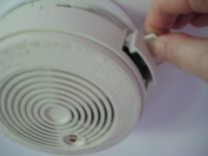 Smoke detector with battery drawer