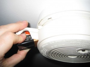 Smoke alarm with battery drawer