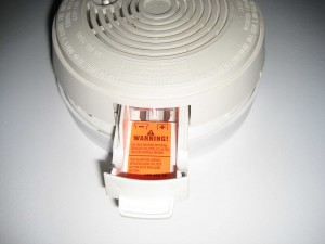 Smoke detector battery drawer