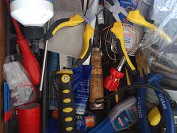 Man drawer full of tools and other odds and ends