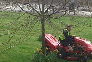 Mowing the lawn ride on lawnmower