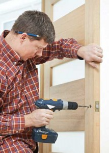 Fitting a lock into a timber door 214x300 How to Install a Wooden Door?