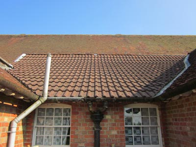 Roof showing old and modern terractta roof tiles 5 Tips for Dealing with Home Renovations in Winter