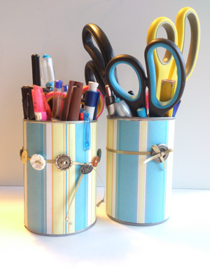 tin cans upcycled and repurposed as storage pots