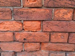 Weathered brick wall Damage to Brick Walls and Plaster