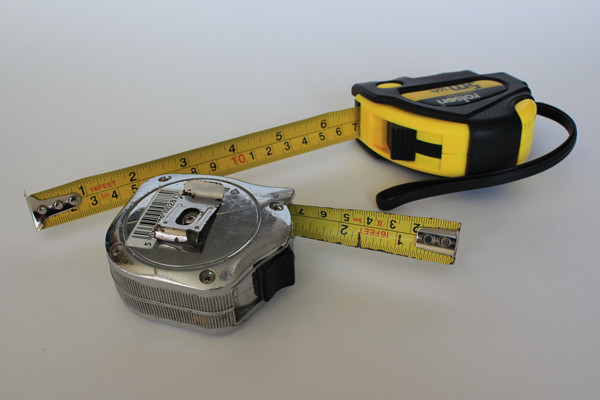 Tape Measures on white 6 10 Tools Every Home Should Have
