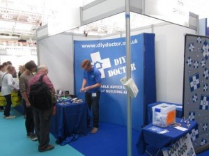 Charles Dowson manning the DIY Doctor Stand at Olympia 300x224 DIY Showman