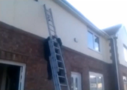 Falling off a ladder video still DIY Doctor Solves Problems When Working Up a Ladder