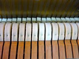 Piano hammers coated in wool