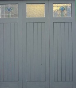 Primed wooden garage doors