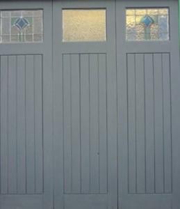 Primed wooden garage doors