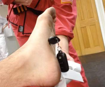 Car keys in foot