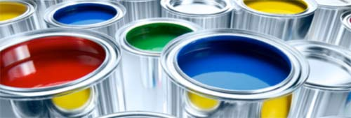 Cans of different coloured paints
