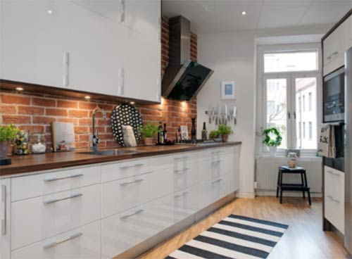 Exposed brick kitchen feature wall