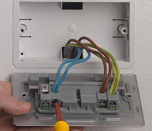 Loosen electrical terminals on rear of socket