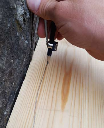Scribing uneven surface to a piece of timber
