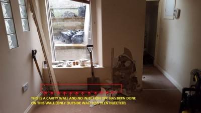 Front of property inside living room not injected, only injected from outside which one hole i checked here was 32 cm depth yet the whole cavity wall thickness is 52cm.jpg