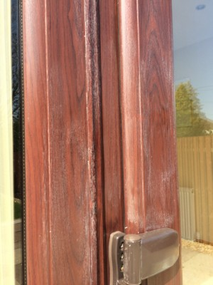 Discoloured Roswood UPVC - close up.jpg