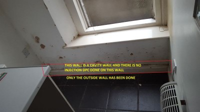 Front of property in kitchen where no Injection DPC done, only injected from outside wall.jpg