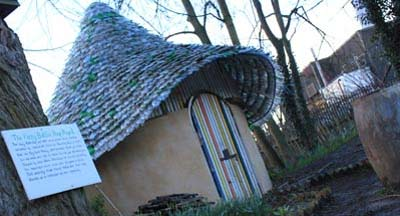 Cob house with mosaic floor and recycled plastic bottle roof