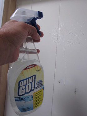 Degreasing paintwork with Grime Go to get ready for new paint on a door
