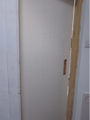 Cleaning a ledged and braced door to prepare for paintwork
