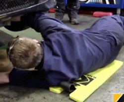 Under a car with a Kneezy protection pad