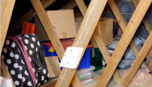 Boxes piled high in the loft before Loft Ledge
