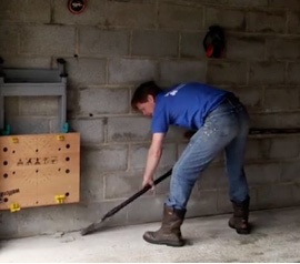 Scraping concrete and mortar spills from slab