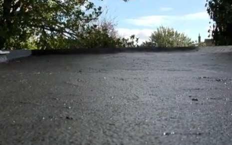 Smooth bitumen roof repair on flat roof