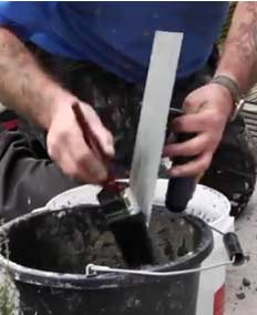 Cleaning a finishing trowel with Safer Solvent