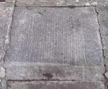 Cracks in concrete pathway
