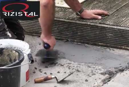 Using a plasterers finishing trowel to smooth epoxy repair mortar