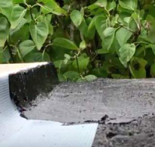Repair mortar applied to mesh