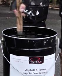 Stirring a can of tarmac restorer