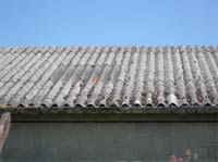 Asbestos roofs can be dangerous so seek local authority advice before touching them