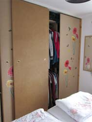 Sliding wardrobe doors take up less room in a bedroom