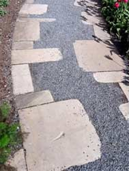 Laying garden paths in a variety of materials can give your garden a landscaped feel