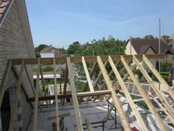 Roof trusses in a traditional roof showing trimming out for roof window