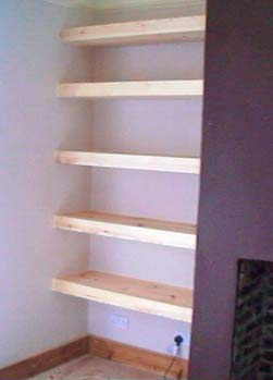 Fitted shelves in alcoves can help you de-clutter