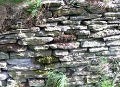 Dry stone walls are still built across the UK and dry stone walling has become a growing craft again