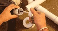 Joining plastic waste pipe with solvent weld cement