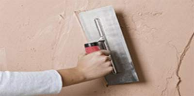 Applying plaster to a wall