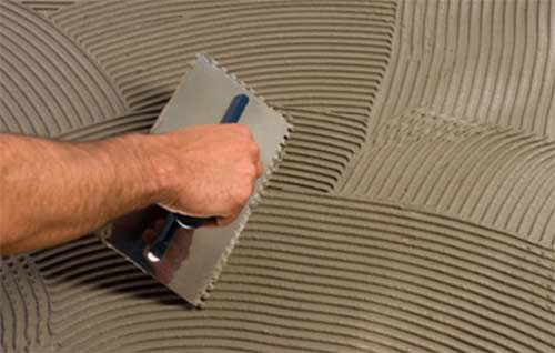 Applying tile adhesive