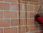 Cutting and Filling Chases in Brick and Concrete Walls for Wiring and Cables and Filling for Plastering