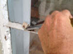 How to Use a Chopping Knife to Chop Out Putty and Remove Glass from a Window