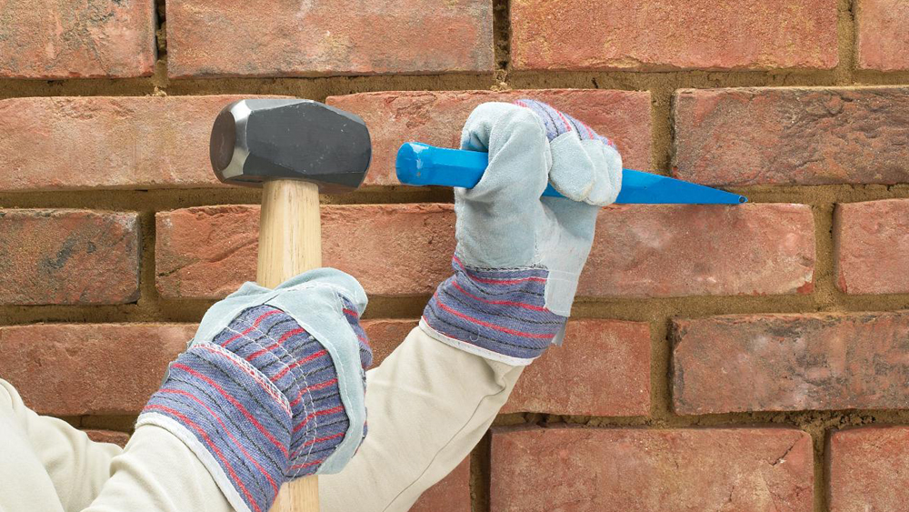 How To Clean Mortar From Bricks Using A Hammer And Bolster