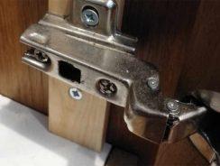 Concealed cabinet door hinge