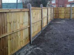 Panel fence constructed using concrete fence posts